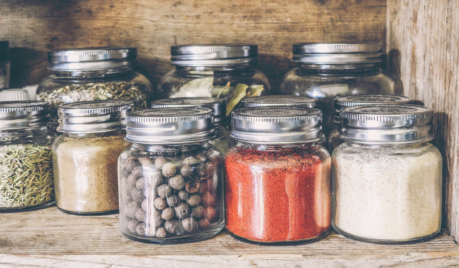 Purpose of Salt and Bay Leaves in a Glass spices in jars